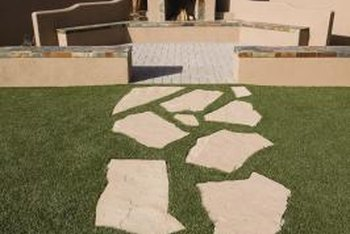 Plain, old grass works well between flagstone pavers.
