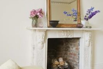 Paint a concrete fireplace the same color as surrounding walls for a blended look.