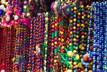 Use inexpensive Mardi Gras beads for outdoor decorations.