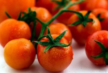 Cherry tomatoes produce small-sized tomatoes throughout the summer.
