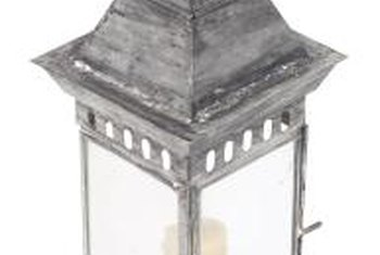 Distress glass panes on a lantern to diffuse light and create a subtle aged effect.