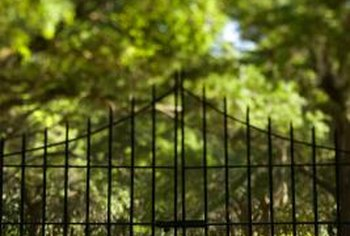 A decorative gate at a garden path's entrance lends security.