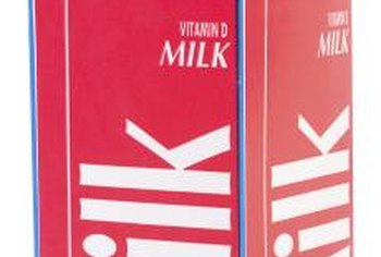 Milk cartons function as single-use molds for homemade ice candles.