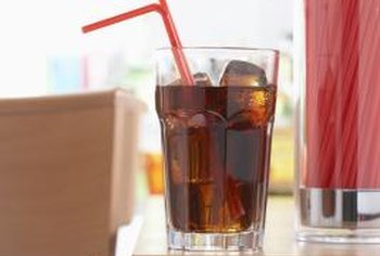 The acids in soda can lead to tooth decay and decreased bone mineral density.