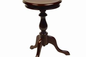 Pedestal tables feature a thick central post supported by several small legs.