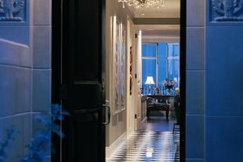 A tiled entry lends hotel grandeur to an ordinary home.