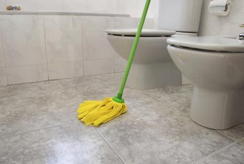 The Bathroom Floor Needs Disinfecting, And Vinegar Works Best.