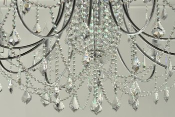 Arc clear bead strands between low and high parts of the chandelier for an elegant touch.