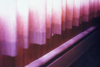 Curtains and drapes should be hemmed so that they do not obstruct baseboard heaters.