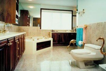 Seal your marble bathroom floor to protect it from a variety of liquids.