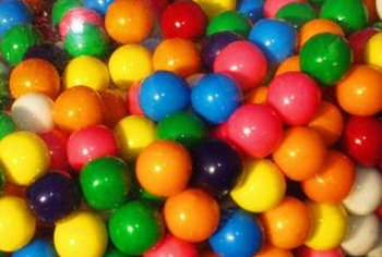 Chewing gum contains polymers and waxes that can bind to ultrasuede and other materials.