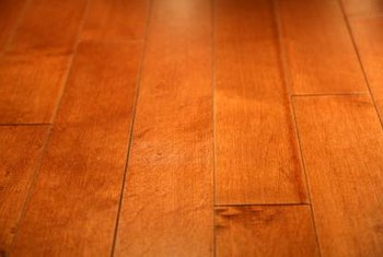Remove tape residue from hardwood floors to bring back their original luster.