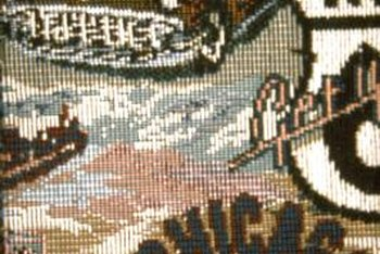 Individual stitches create the design in needlepoint tapestry work.