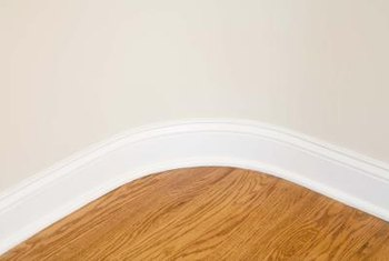 Use flexible vinyl floor molding to trim the base of curved walls.