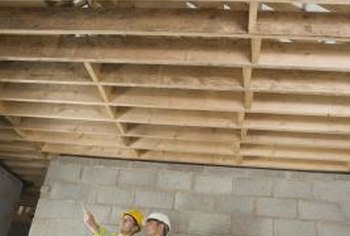 Reinforce substandard joists to strengthen the floor.