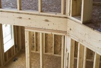Building codes require floor joists to be properly secured with joist hangers.