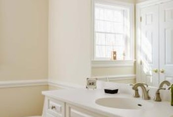 Faux finishes such as a color wash transform a plain bathroom vanity.