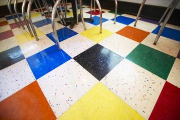 Vinyl foor tiles are available in colors at home centers and flooring outlets.