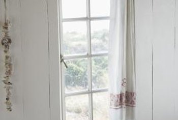 Revive old curtains by combining new and existing fabrics.