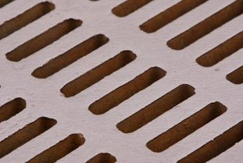Surface drains have steel grates that cover the discard channel.