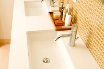 Keeping a solid-surface vanity top dry helps prevent water spots.