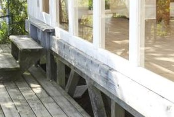 Washing your deck with oxalic acid gets rid of the gray color.