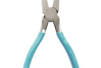 Needle-nose pliers are used for a variety of minor appliance repairs, including such a glow igniter.