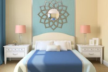 Teal and tan jazz up a blue and white room without straying too far outside the palette.