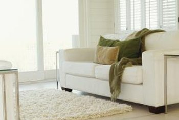Wash throw pillows and blankets to eliminate sour smells on them completely.