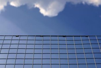 Welded wire fences define yard boundaries without blocking breezes.