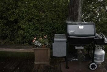 A grill requires a level base away from flammable structures and vegetation.