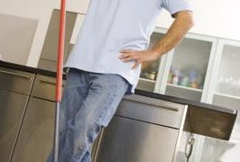 A dry mop cleans the surface before buffing.
