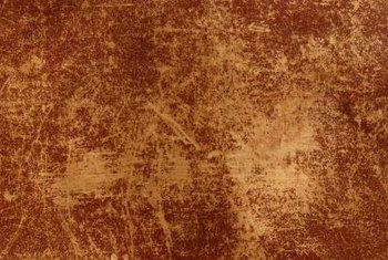 A faux leather effect simulates the cracks, veins and creases of worn natural leather.