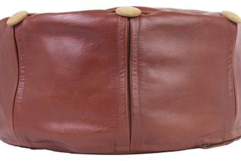 Leather is a durable material for an ottoman, octagonal or otherwise.