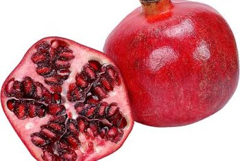 Dwarf pomegranate trees have attractive flowers and produce fruit.