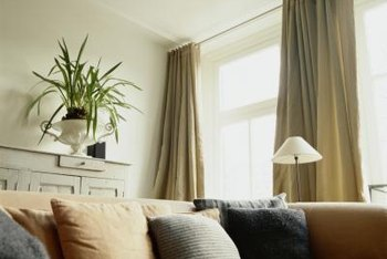 hanging curtains at ceiling level draws the eye up potentially making a small room feel - Hanging Drapery