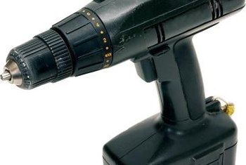 A cordless drill makes it easier to install recessed light fixtures.