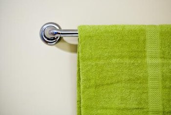 Attach a towel rack using wall toggle bolts.