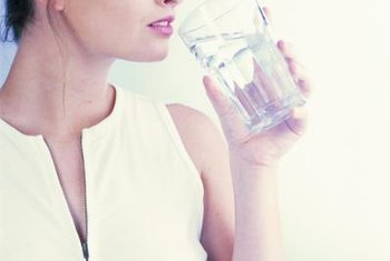 Drink a glass of water with your liquid iron supplement.