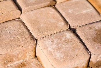 Porous concrete and brick pavers are easy to split, while dense pavers often must be cut with a saw.