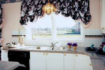 Fussy, voluminous curtains draw unwanted attention to out-of-proportion windows.