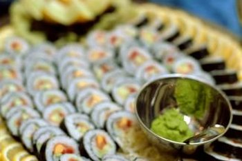 Sushi rolls are wrapped in toasted nori, a type of sea vegetable.
