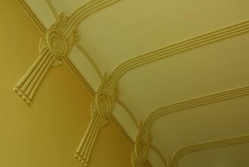 Emphasizing architectural details with paint adds visual interest to a ceiling.