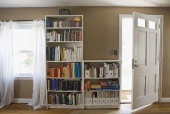 Not just for books anymore, use bookcases to house bins for needed storage.