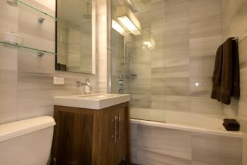 Some tub and shower areas are tiled into the rest of the room.