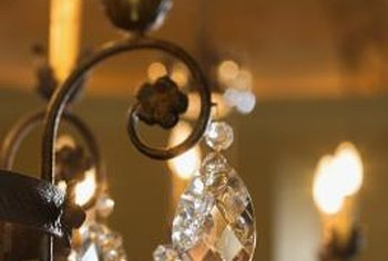 Update an old chandelier with a fresh coat of paint or replacements for the original crystals.