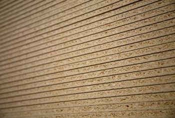 Stacked particleboards in cross-section reveal their pressed sawdust composition.