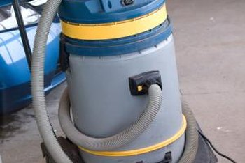 A shop vac will help you prepare an old concrete garage floor for painting.