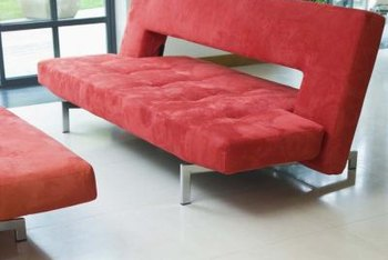Decorate around a red sofa using either warm or cold colors.
