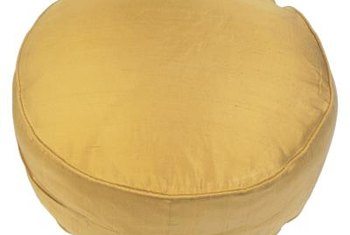 Medium- to heavyweight fabrics, such as cotton or upholstery linen, make durable slipcovers.